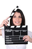 Woman using movie clap — Stock Photo