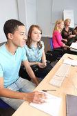 Teens in computer class — Stock Photo