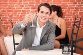 Man toasting with glass — Stock Photo