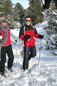Couple snowshoeing — Stock Photo