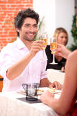 Couple celebrating in restaurant — Stock Photo