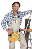 Carpenter wearing a toolbelt — Stockfoto