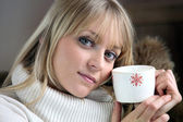 Woman chilling-out with coffee on sofa — Stock Photo