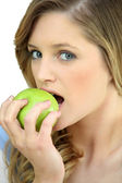 Girl eating a crisp green apple — Stock Photo