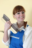 Decorator holding wallpaper brush — Stock Photo