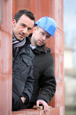 Two site workers hiding in unfinished house — Stock Photo