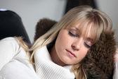 Blond woman having a nap on sofa — Stock Photo