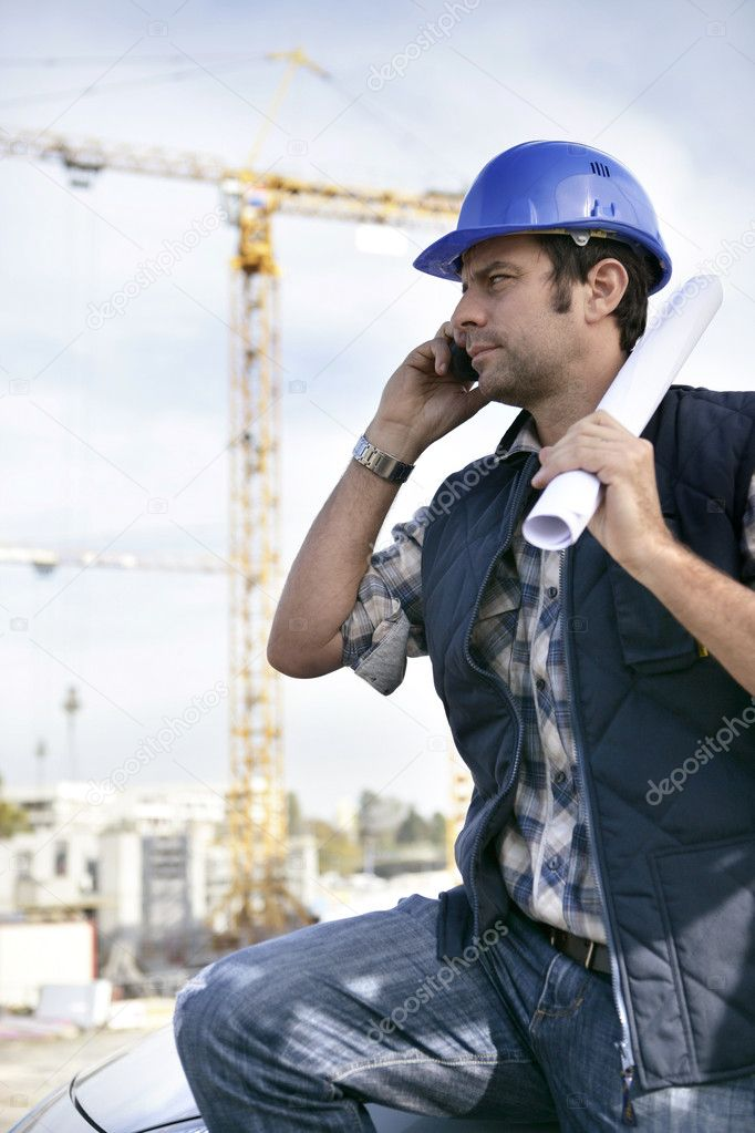 Foreman stood with site in the background — Stock Photo #9326584