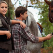 Teens with horses — Stock Photo #9578314