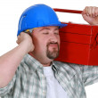 Construction worker listening to the sweet sounds of his toolbox — Stock Photo