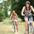 Girls on bikes — Stock Photo
