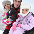 Family in the snow — Stock Photo
