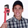 Happy plumber - Stock Photo