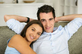 Young couple relaxing on the sofa — Stock Photo
