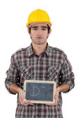 Unhappy tradesman giving a grade of D minus — Stock Photo