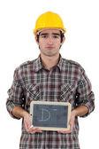 Unhappy tradesman giving a grade of D minus — Stock Photo