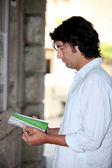 Man reading a tourist brochure — Stock Photo