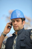 Foreman in construction site making a call — Stock Photo