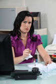 Angry woman crumpling papers — Stock Photo