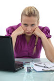 Grumpy blond office worker — Stock Photo