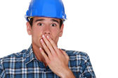 A terror-stricken tradesman — Stock Photo