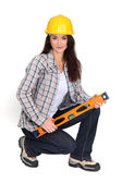 Woman kneeling with spirit-level — Stock Photo