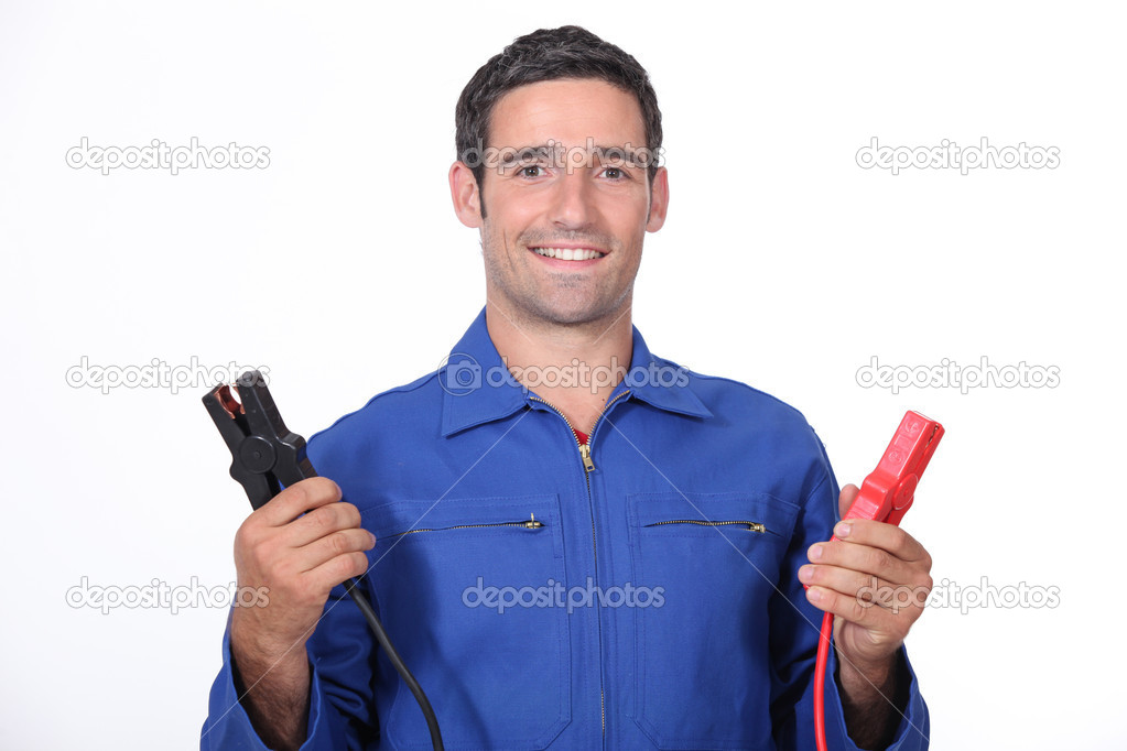 Man car mechanic with alligator clips — Stock Photo #9578271