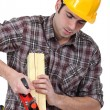 Man planing wood — Stock Photo