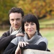 Couple in the autumnal countryside — Stock Photo