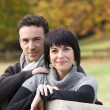 Couple in the autumnal countryside - Stock Photo