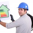 Electrician with an energy rating card — Stock Photo #9580997