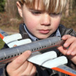 Boy holding toy plane — Stock Photo #9581011