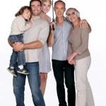 Smiling family under an umbrella — Stock Photo #9581078