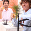 Friends eating in a restaurant — Stock Photo