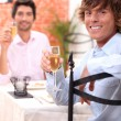 Stock Photo: Friends eating in a restaurant