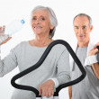 Elderly couple working out together — Stock Photo