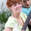 Couple playing the guitar together — Stock Photo