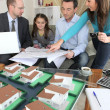 Young family sitting in an architect's office — Stock Photo
