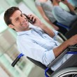 Disabled worker on the phone — Stock Photo