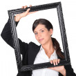 Woman behind black frame — Stock Photo