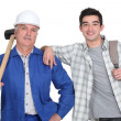 Manual worker and a young man with a rucksack — Stock Photo