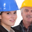 Young architect with senior builder — Stock Photo #9582283