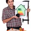Stock Photo: Mholding up energy efficiency rating sign