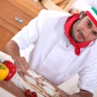 Italian chef making pizza — Stock Photo