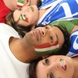 Four Italian soccer fans laying on the floor — Stock Photo
