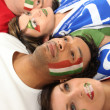 Royalty-Free Stock Photo: Four Italian soccer fans laying on the floor