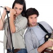 Stock Photo: Couple rocking in a band