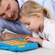 Stock Photo: Man playing a toy computer with a little girl