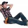 A young construction worker resting. — Stock Photo