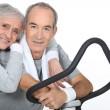 Sporty senior couple with cross trainer — Stock Photo #9583795